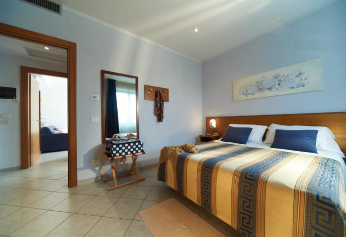 Foto camera quadrupla - Hotel Sirio a Lido di Camaiore in Versilia, Toscana